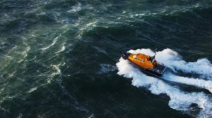 RNLI lifeboard floating through waves