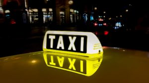 Yellow taxi sign