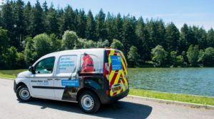 Wessex Water van by a lake and forest