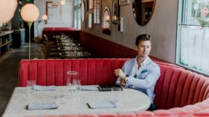 Businessman sitting alone in bar